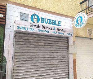 Banderola redonda luminosa a doble cara, y decoración de fachada forrado con panel composite y vinilo, para Bubble de Fuengirola.